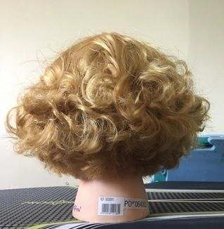 Horizontal graduated bob on permed hair