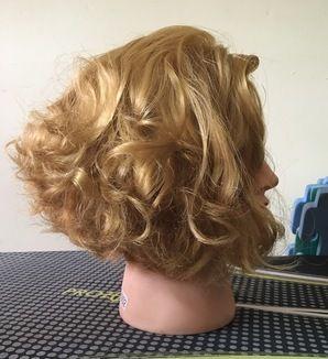 Horizontal graduated bob on permed hair