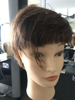 Round layered pixie cut with triple elements
